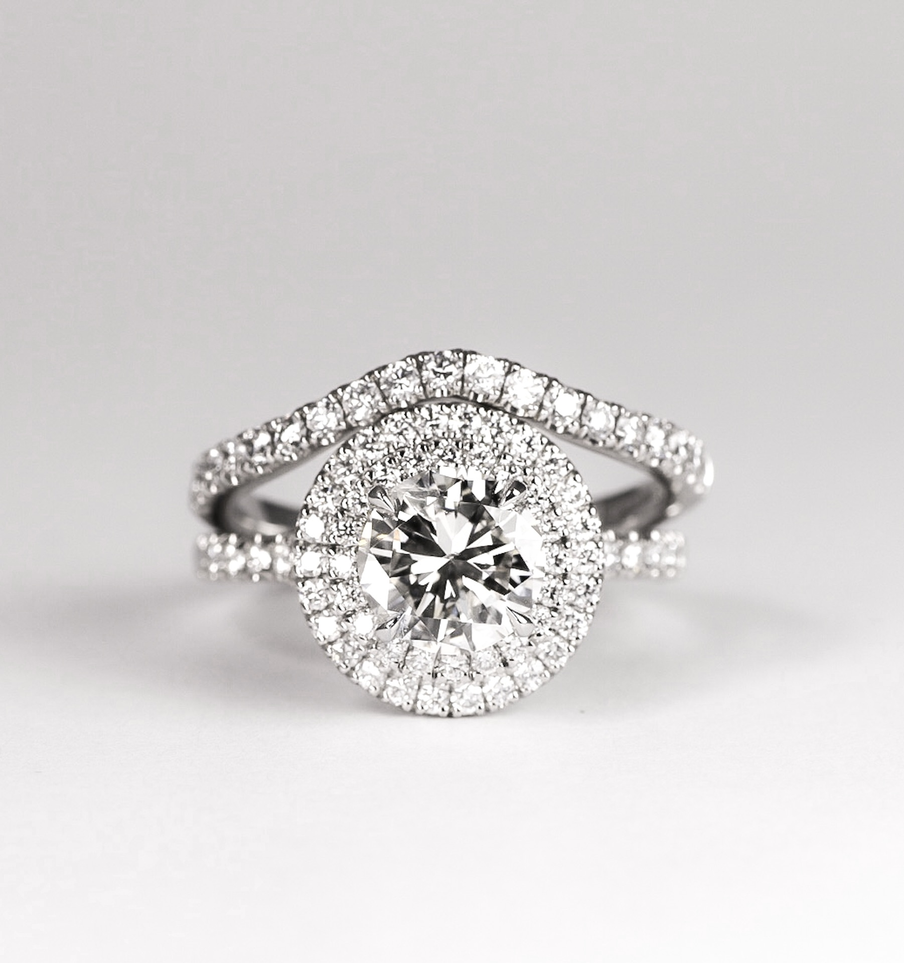 Platinum mounted double halo cluster ring. Made in Chichester, England.