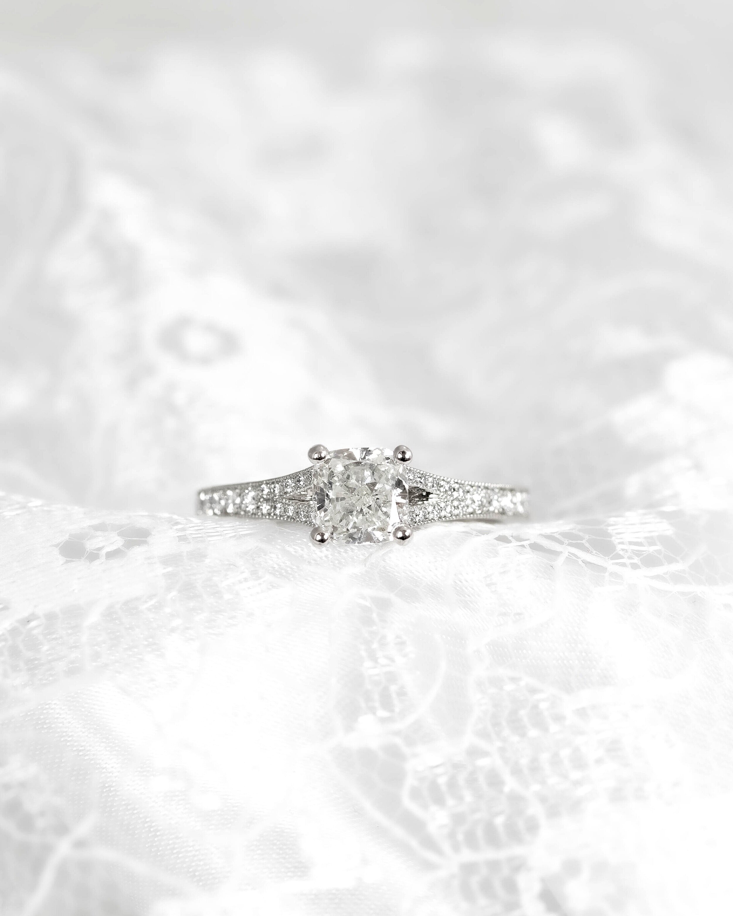 Platinum mounted 1.02ct cushion cut diamond solitaire with grain set split shoulders. Made in Chichester, England.