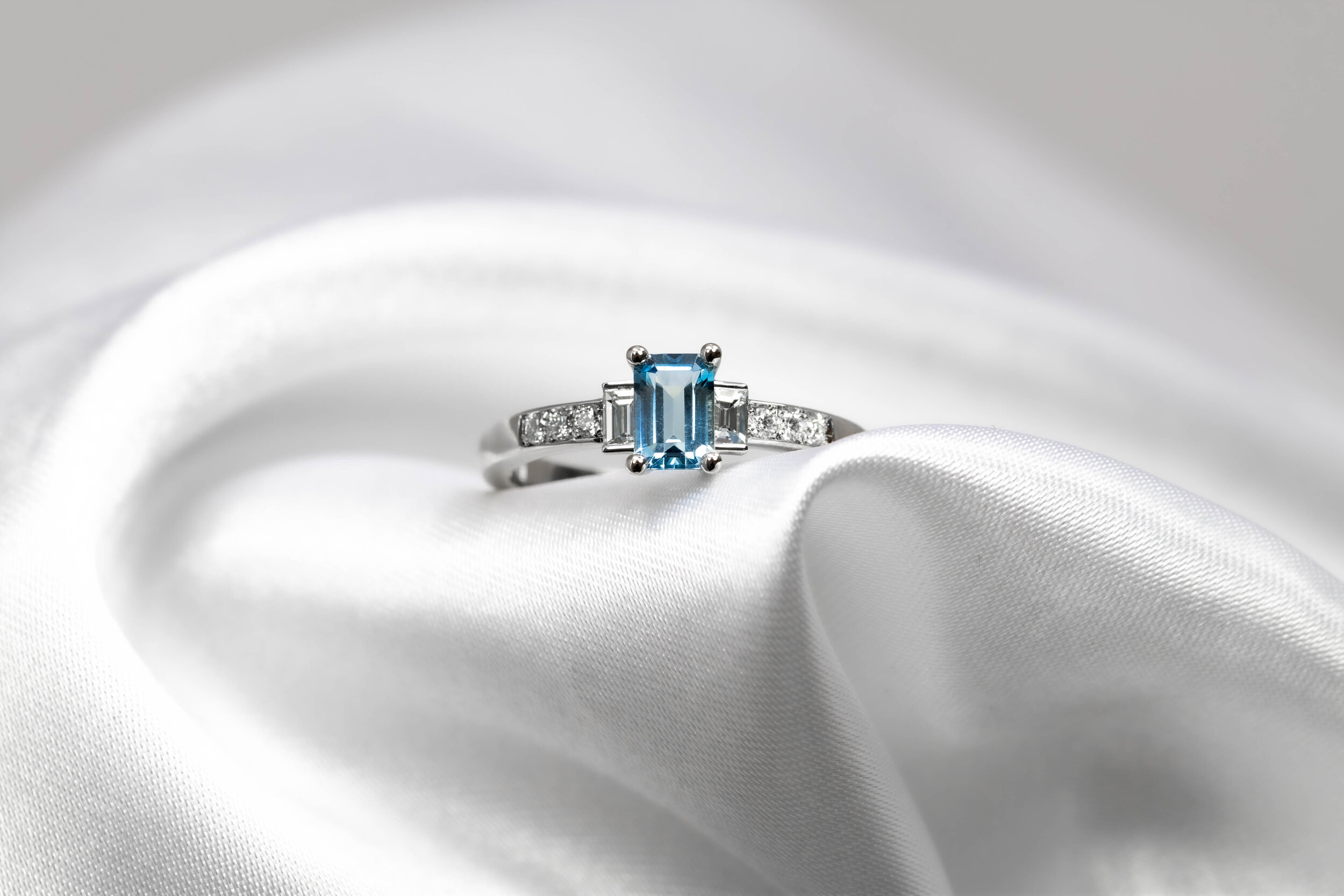 Platinum mounted emerald cut aquamarine, with baguette and round cut diamond set ring. Made in Chichester, England.