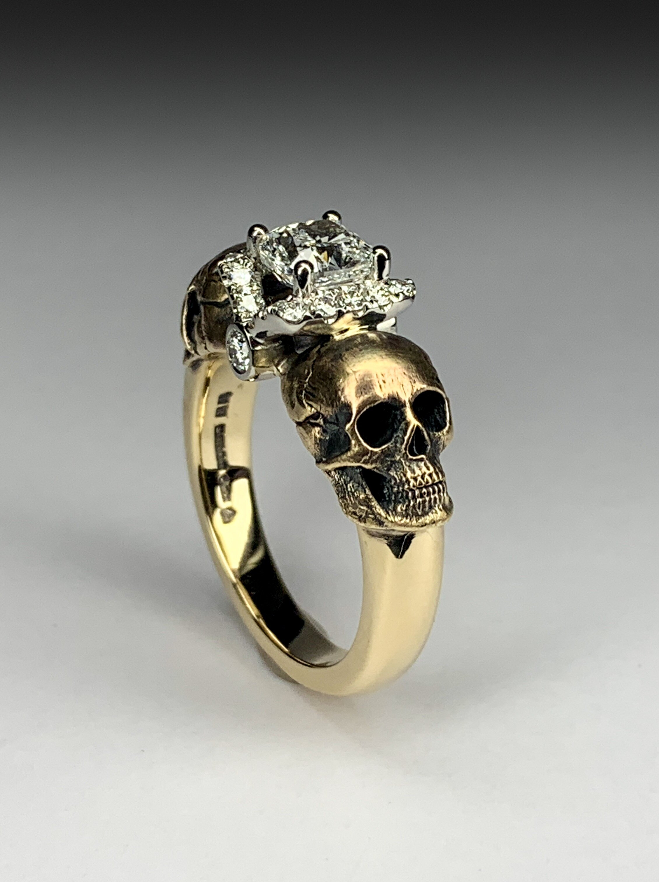 A gold and platinum skull ring made with customers own diamonds. Made in Chichester, England.