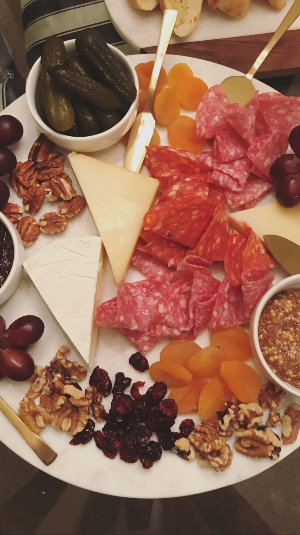 Charcuterie… - Here's what you need to master this:Cheese, darn good, expensive cheese. Italian meats. French baguettes. Dried fruits, fresh fruits. Nuts on nuts. Whole grain mustard. Fig Butter. Mini sweet pickles. Gold cheese knives, of course, all served on a giant marble slab. Katie style.