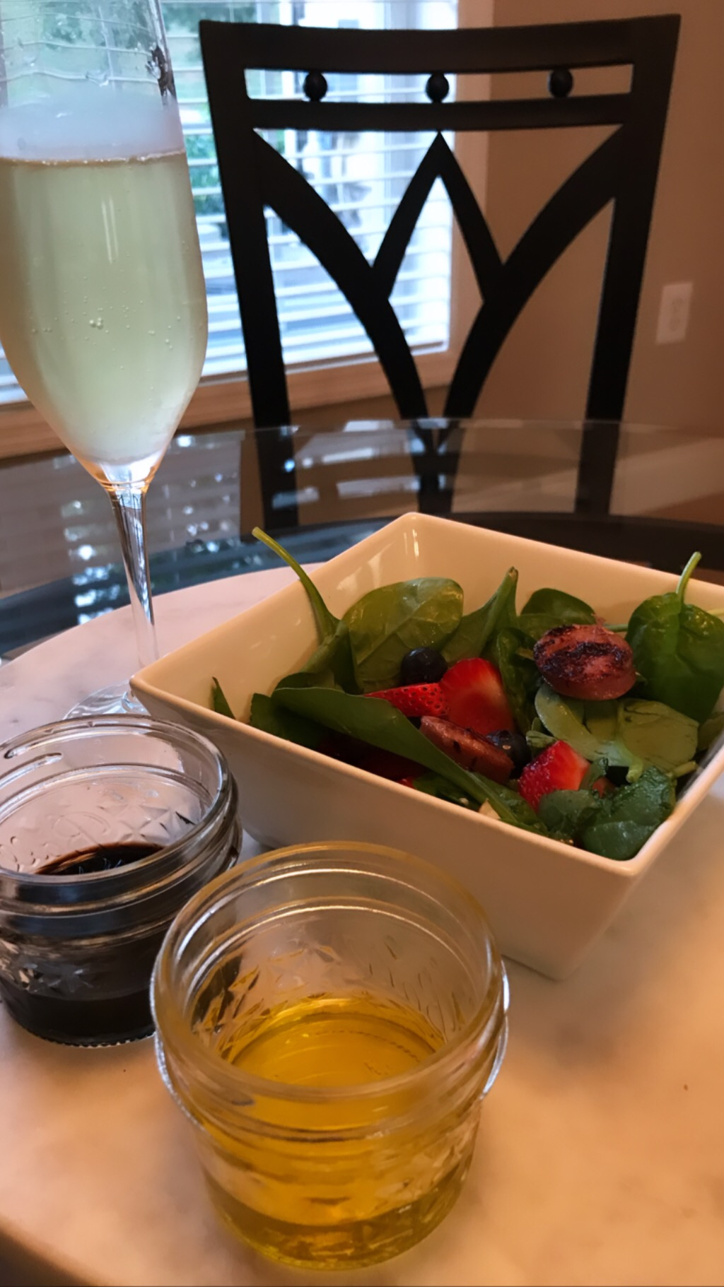 Pairs well with a glass of extra-dry Brut. (: - I dress mine with just a drizzle of extra virgin olive oil. My husband likes balsamic vinaigrette. We also enjoy it with raspberry vinaigrette and red wine vinaigrette.