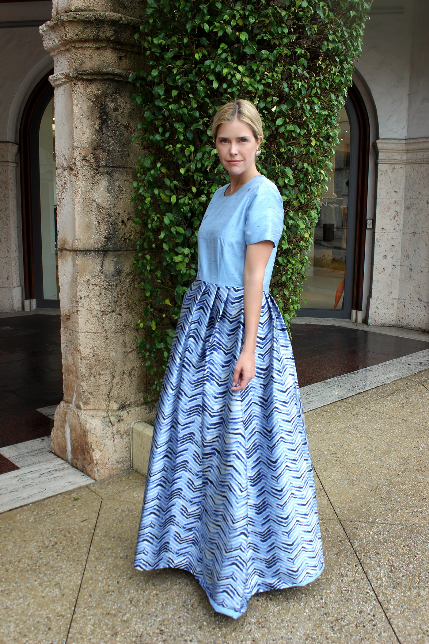 The Fulton Dress is simultaneously cute and elegant. Its simple sky-blue duponi silk top lends center-stage to the full, floor-length pleated blue-wave Ratti silk skirt.