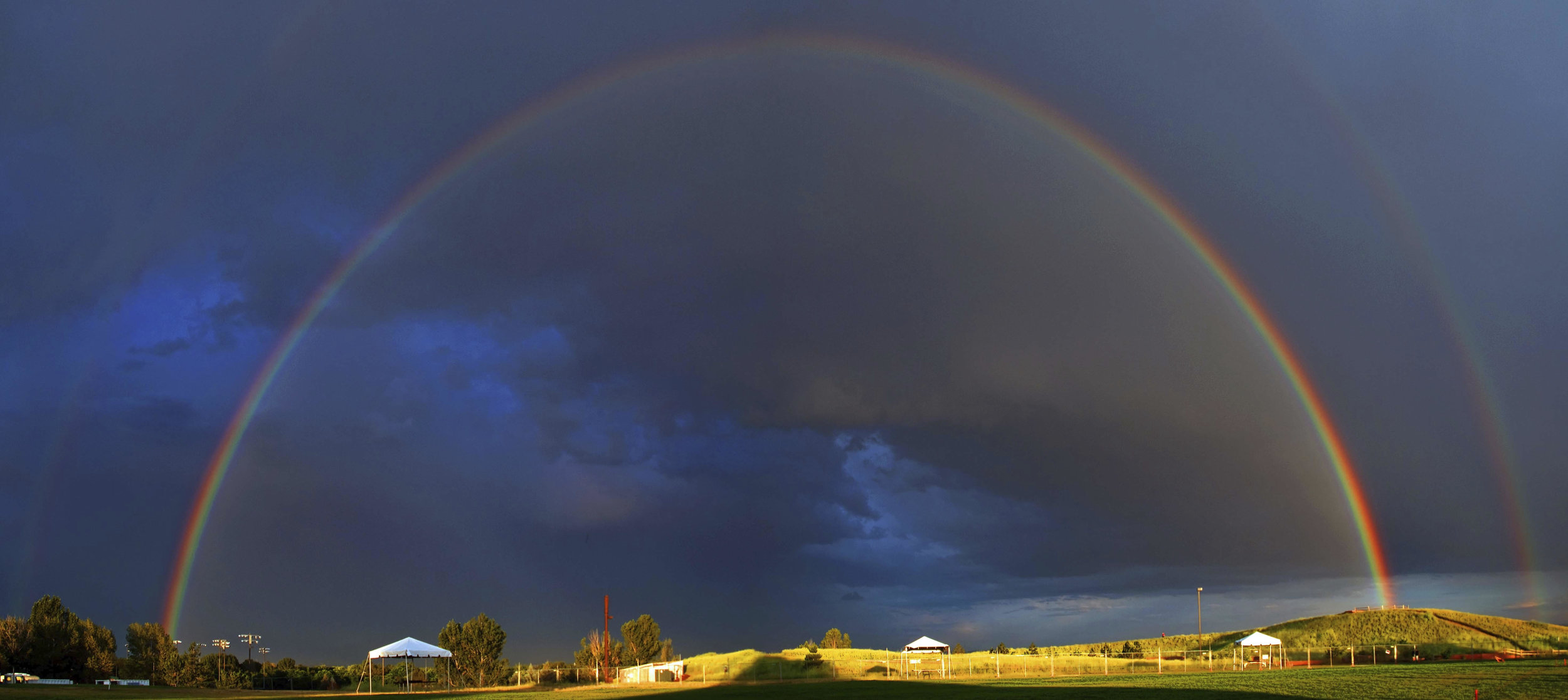 Rainbow over what would become the columbine memorial (behind Columbine HS) provided by Crystal