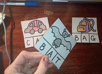 Memory Flip - This game is perfect for building sight recognition of words. You can play it at any level and adapt it using easier or harder vocab. For instance, I take my CVC spelling cards and turn them into this memory game.I hold up three cards at a time and get the student to read them out, slowly at first. Then, we read them faster, picking up a rhythm of the words. Then, I jumble them around and turn one backwards, so the word isn't visible. Animatedly ask, 'which one is missing?!' and the student has to remember the hidden word. It is great fun and can last for as many rounds (or as few) as you need.