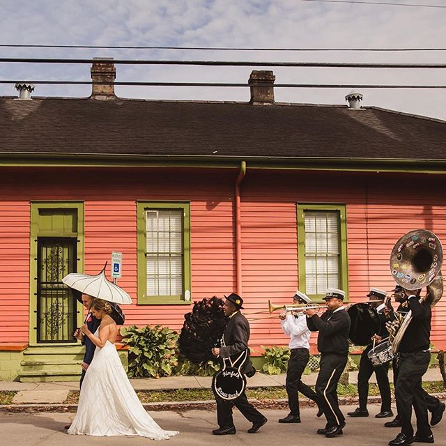 #Repost @spanishoakevents ・・・ One of my favorite second line shots brings you Sarah and Chris, who celebrated their nuptials at the Mazant. The colorful homes in the Bywater made for the perfect backdrop for their entire day.  Captured by: @mateoandcompany