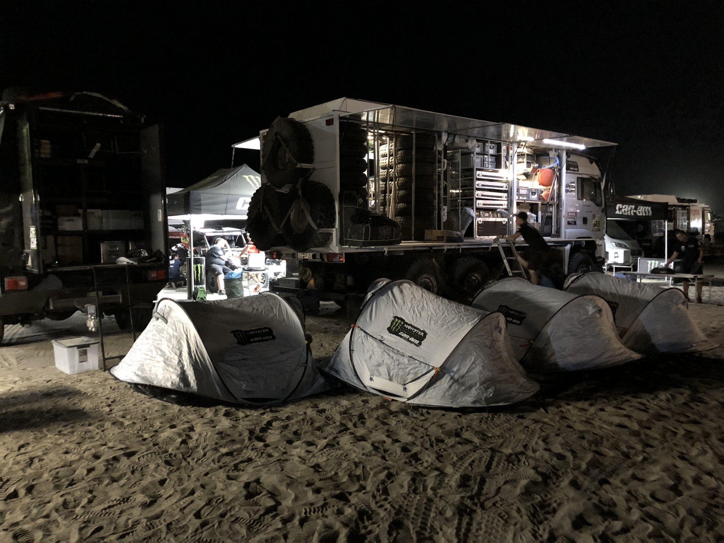 Our tents lined up right behind one of the parts trucks.