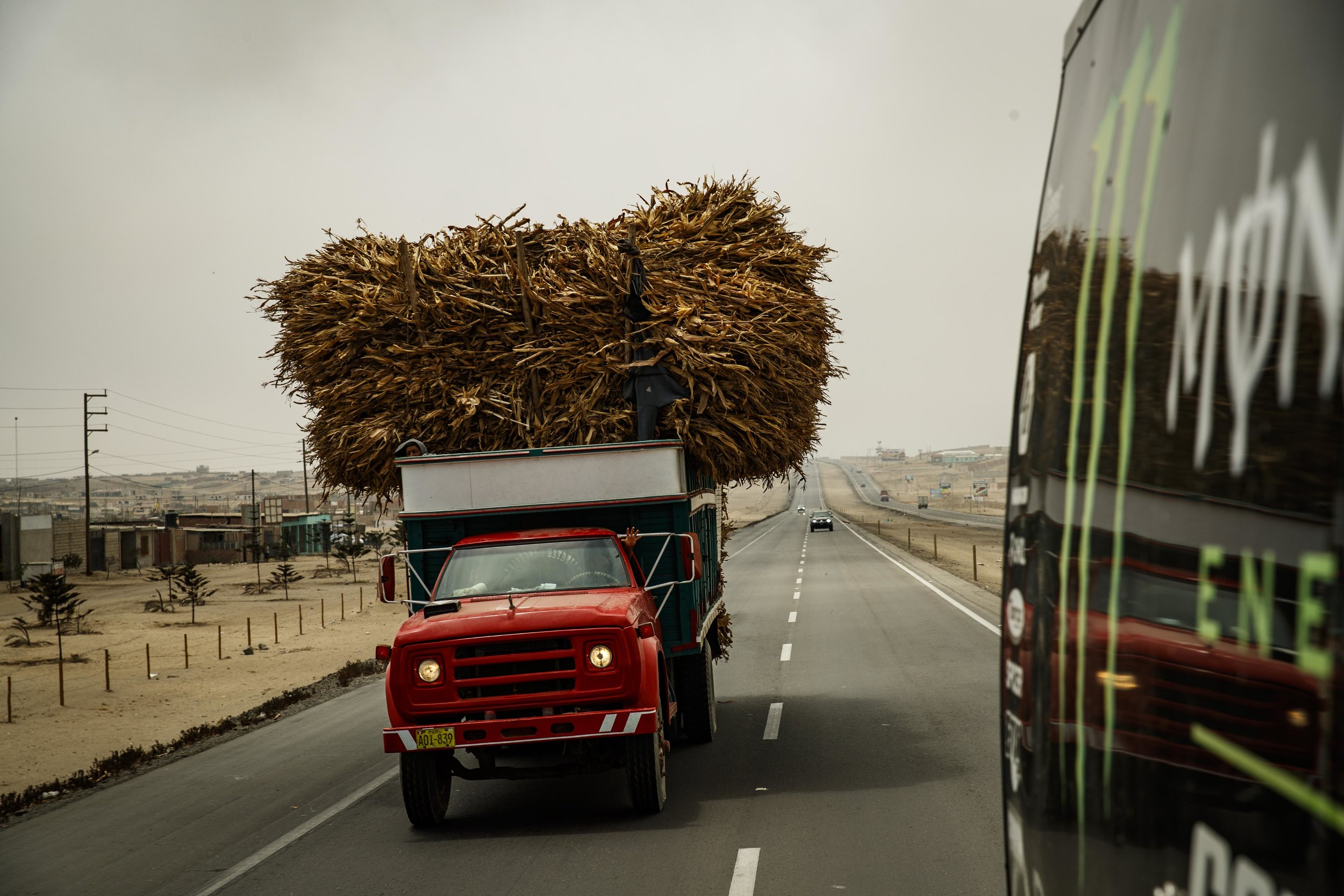 These harvesting trucks stretched from lane to lane in Peru.
