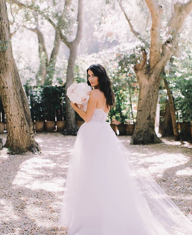 The ever so stunning @maria__corrigan on her Wedding Day this weekend wearing custom Trish Peng.Maria's dress was a floral beaded lace with a detachable tulle skirt💘  Planner + Designer: @charleybluebell Photographer: @jennyquicksall  Florals: @butterflyfloral  Venue: @calamigosranch Gown: @trishpeng