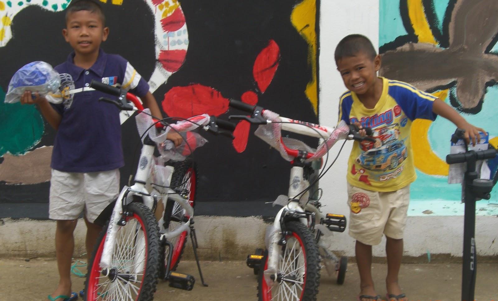 aurora grants volunteering elves and more childrens bikes.jpg