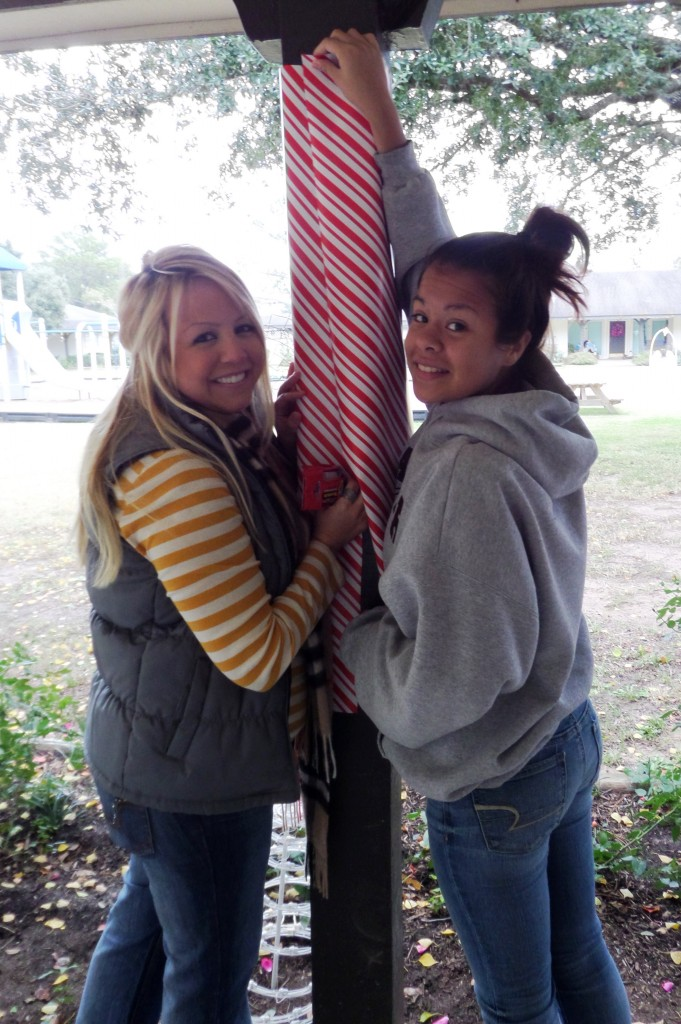 YPG member helps hang Christmas decorations on campus