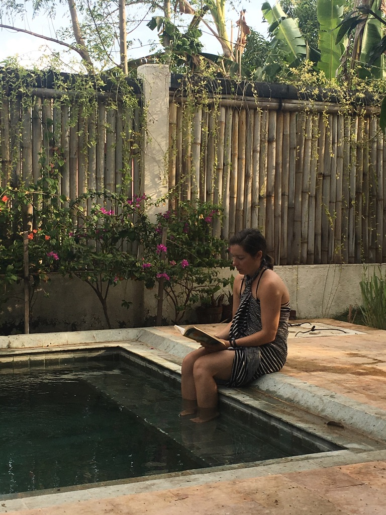Reading poolside at Flowers and Fire Yoga