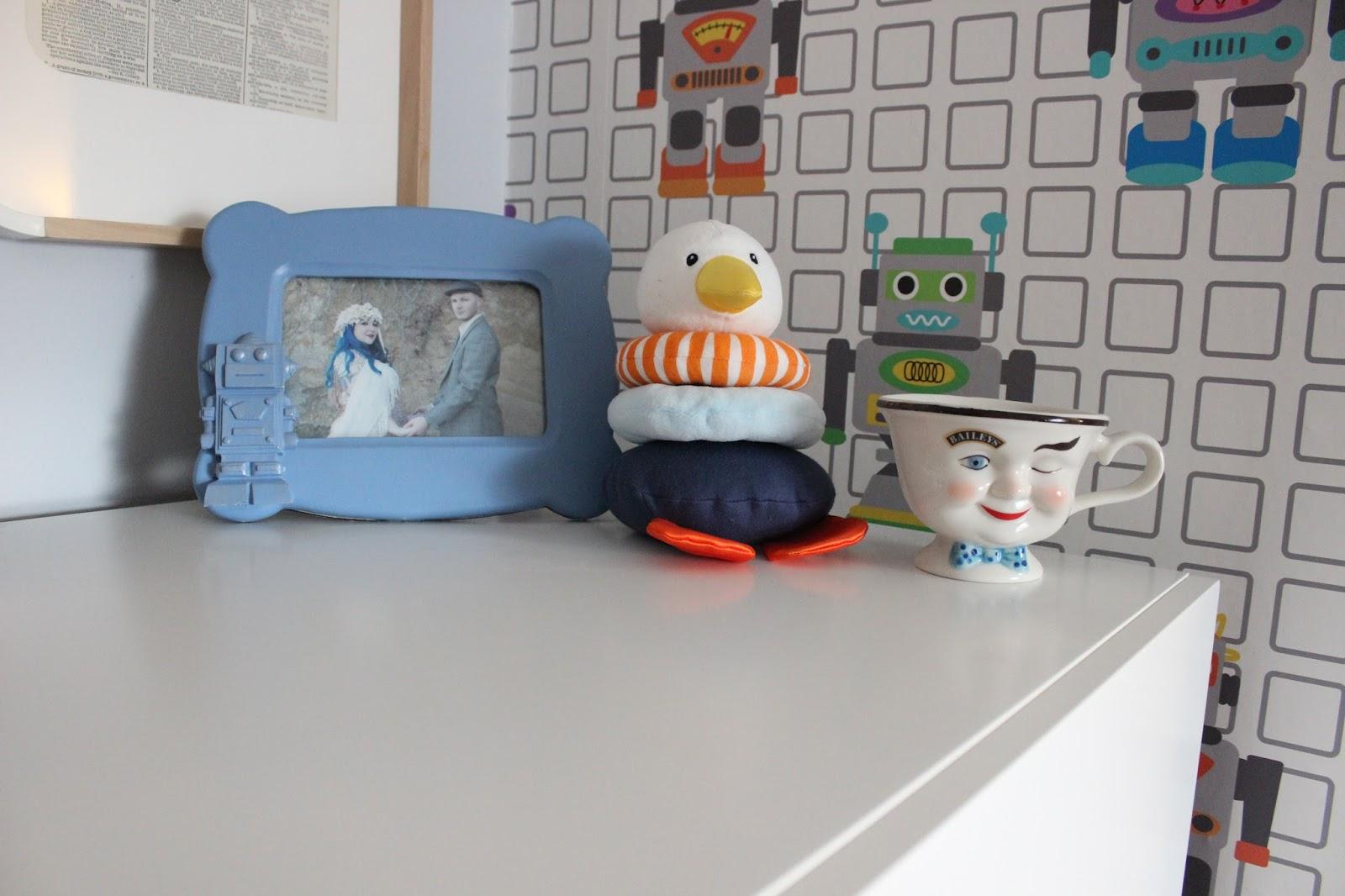 Frame:  HomeGoods   Stacker Toy:   Ikea Leka    Coffee cup:  vintage
