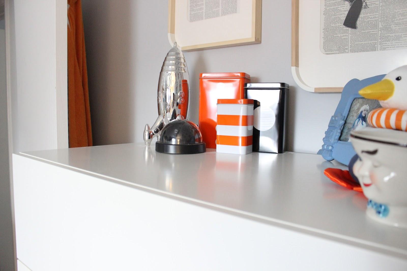 Rocket Bank:  HomeGoods   Tins:  Ikea Tripp (discontinued)