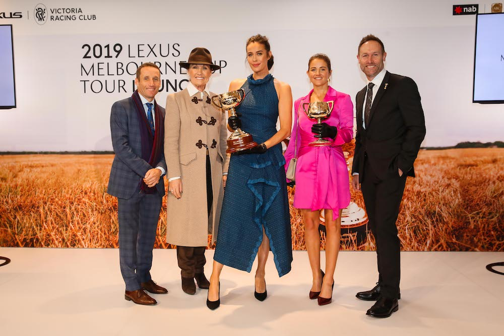 Damien Oliver, Amanda Elliott, Megan Gale, Michelle Payne and Scott Thompson with the 2019 Lexus Melbourne Cup and the 1919 Melbourne Cup copy.jpg