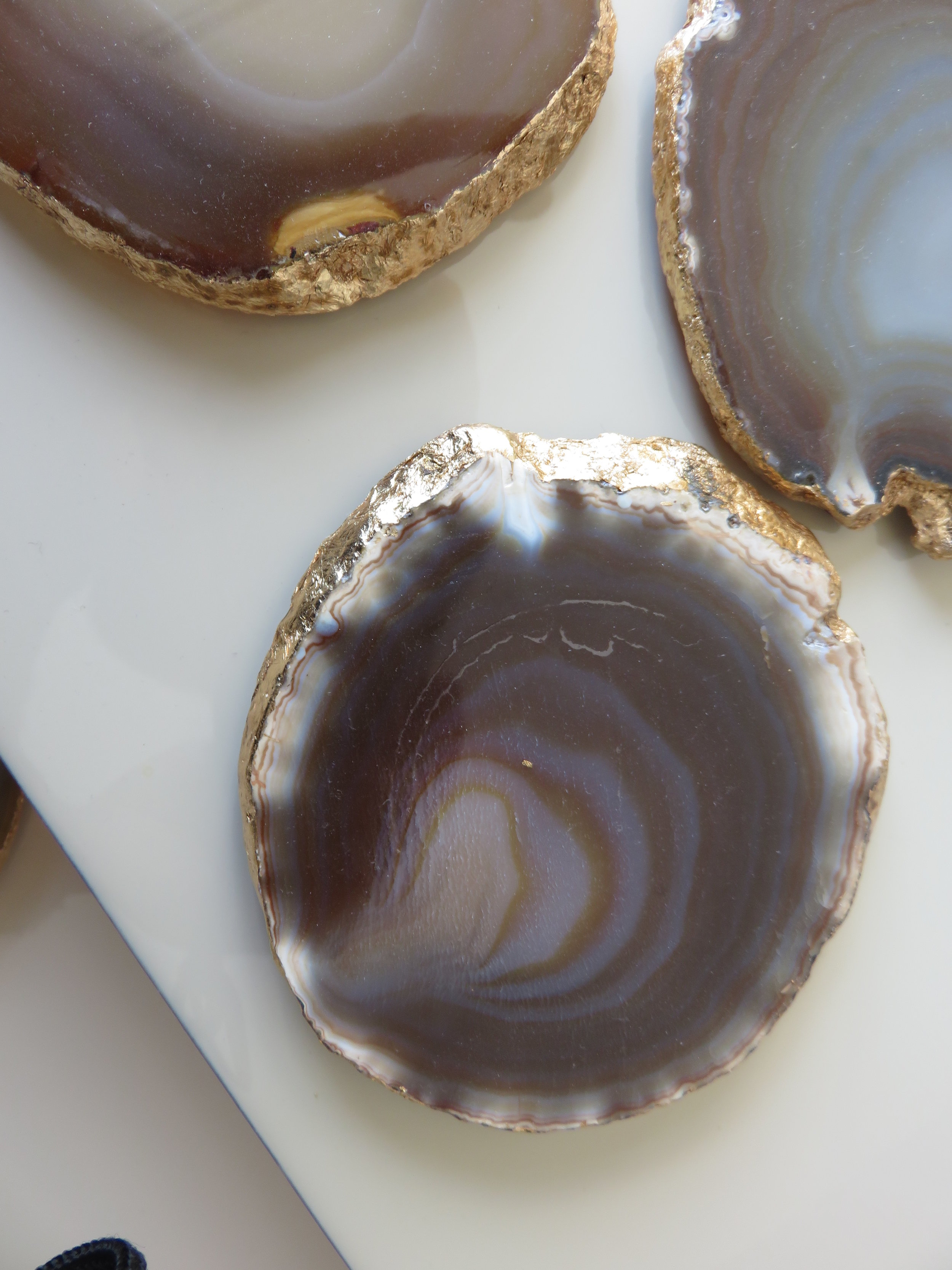Interior designer Sonia Adams sourced these bespoke Agate coasters in natural stone