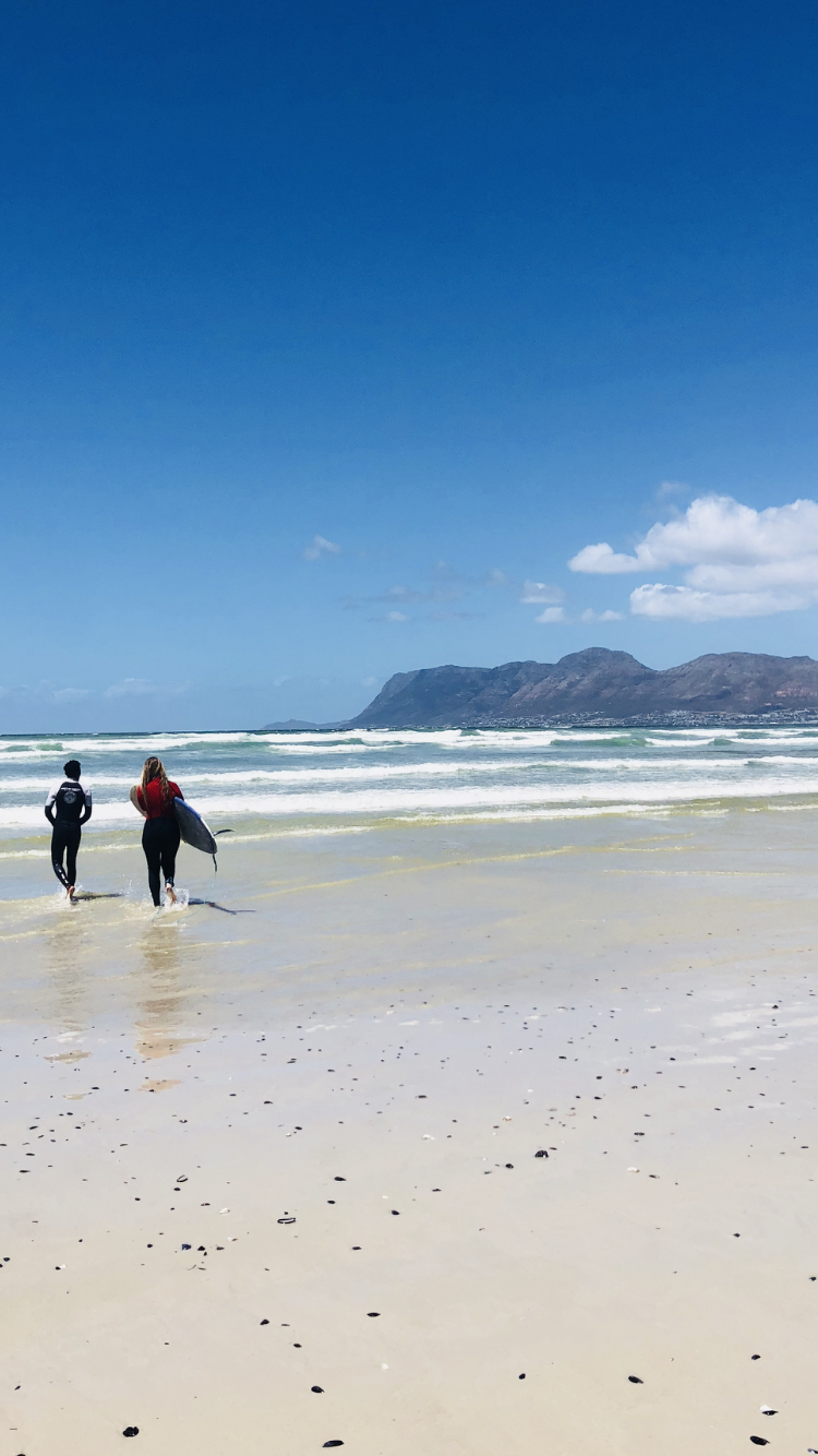 Me learning how to surf in Cape Town, South Africa. I was scared, but I did and it and actually surfed!