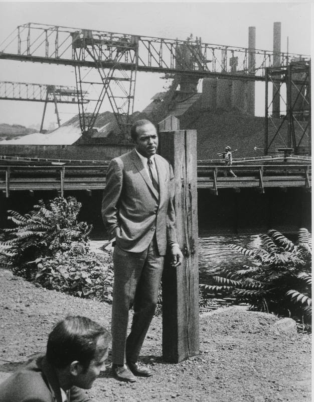 Stokes News Conference, 1969: Mayor Carl Stokes talks to reporters near the site of the Cuyahoga River fire in 1969. Image courtesy of Cleveland State Library Special Collections.