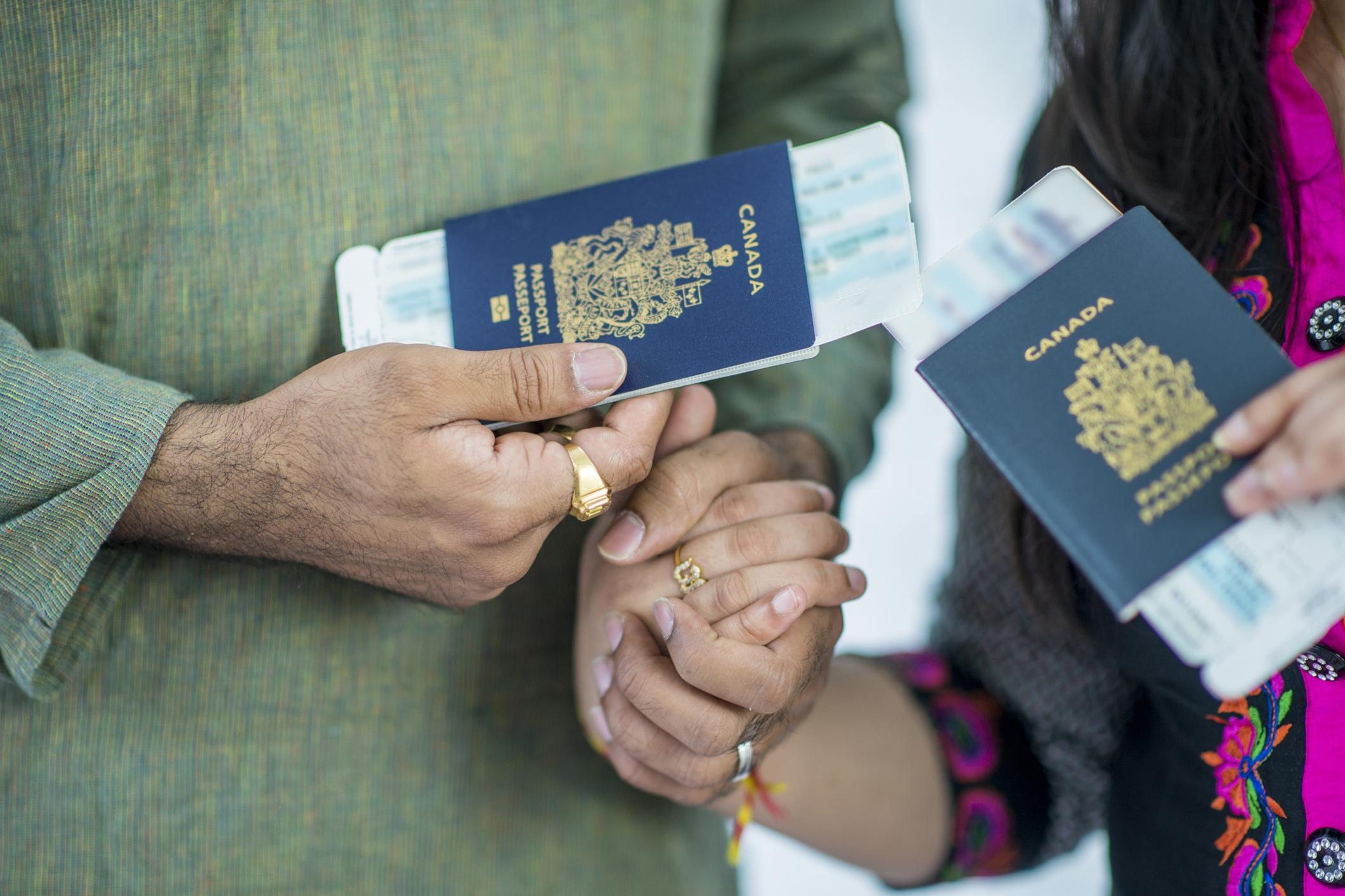 couple holding passports.jpg