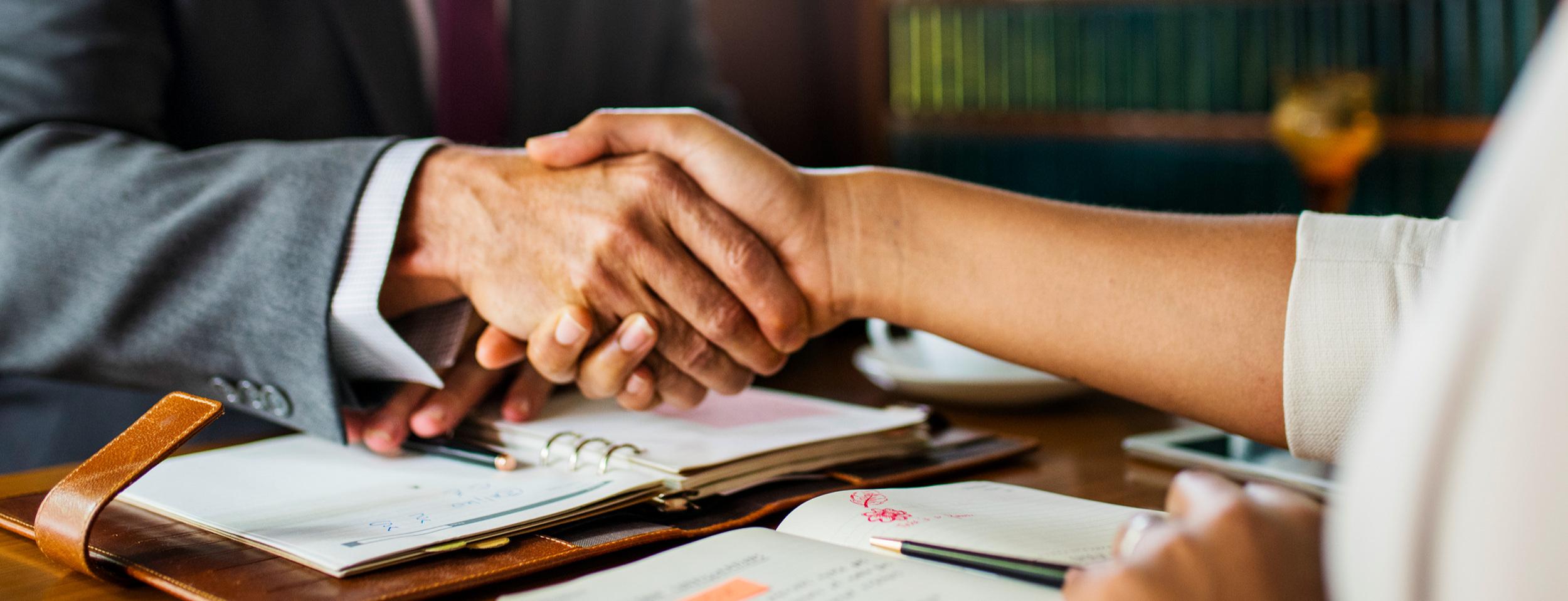 hands shaking over desk