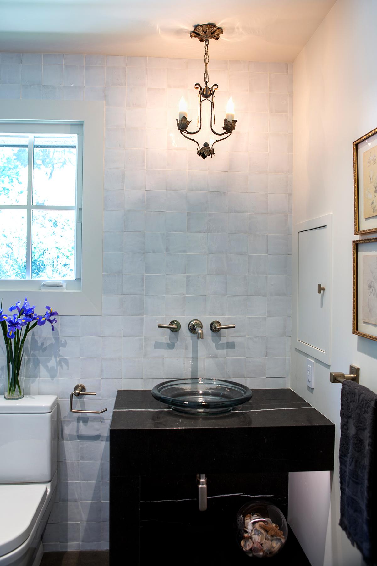 small bathroom with glass sink.jpg