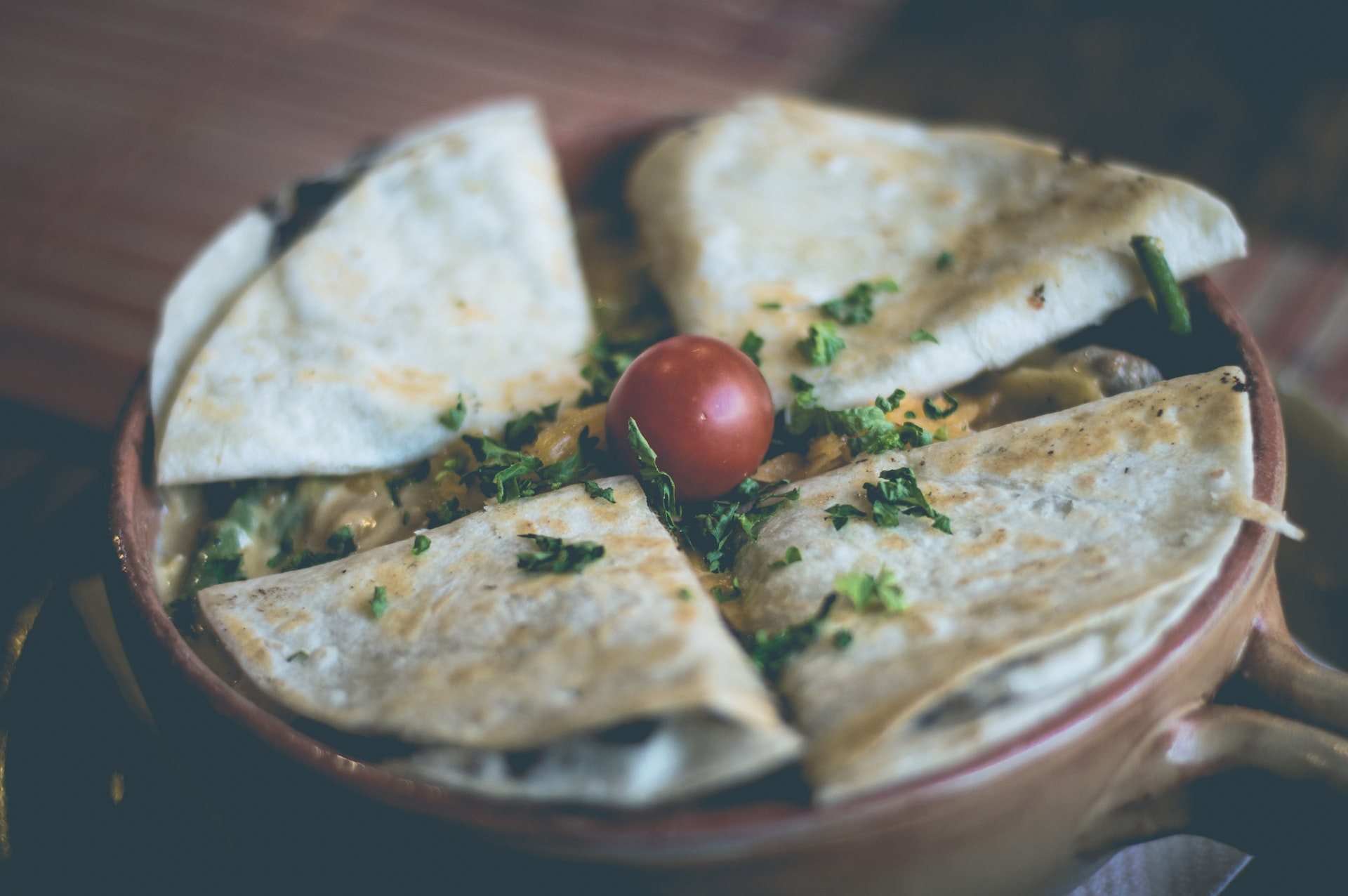 Quesadillas garnished with cilantro and tomatoes