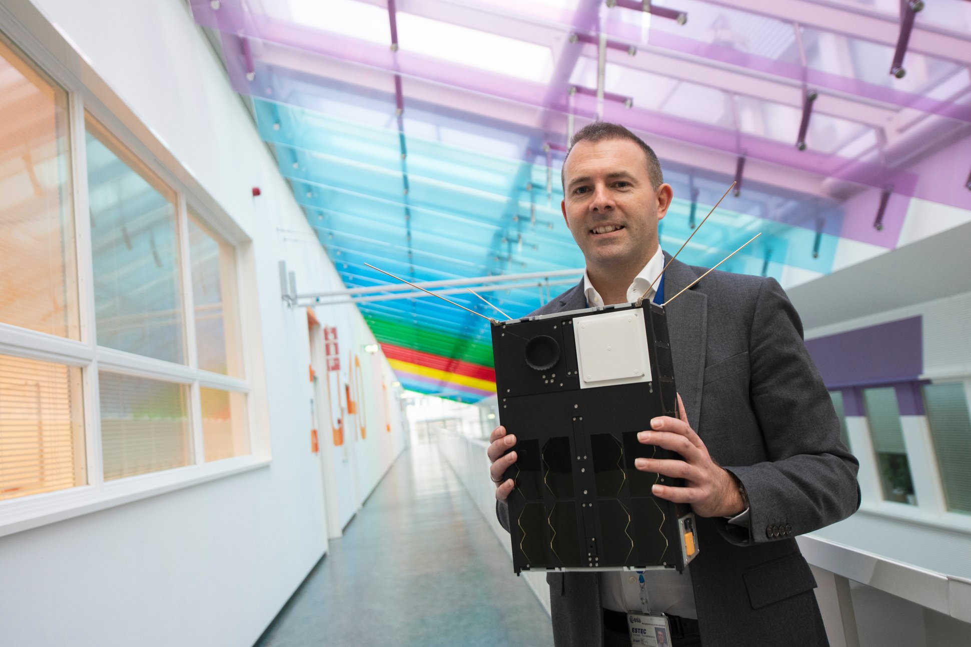 Roger Walker, head of ESA's Technology CubeSats, holding a 3D printed model of GomX-4B, which while the size of a cereal box, is the largest CubeSat ESA has yet flown - Credit: ESA-G. Porter