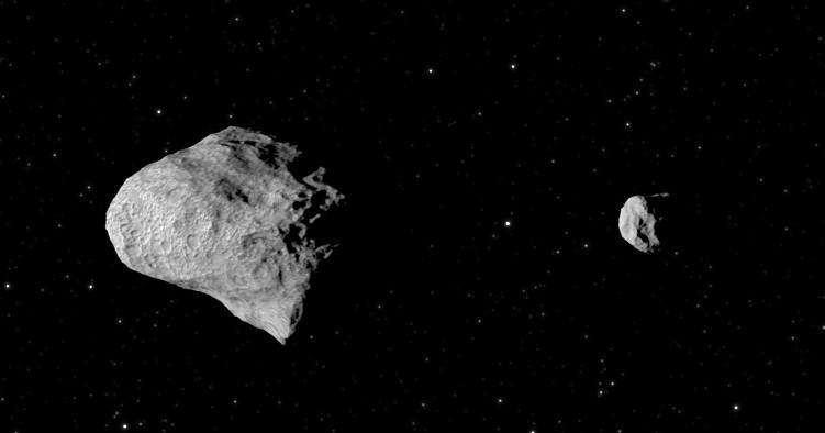 The Didymos binary asteroid system is comprised of a larger object, Didymos and the smaller satellite object, Didymoon. The DART and Hera spacecraft will be the first to visit a binary asteroid system. Credit: ESA
