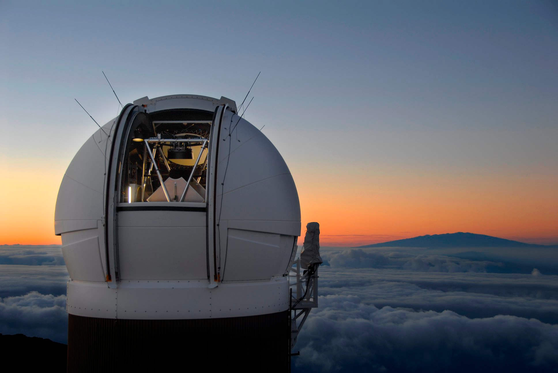 The Pan-STARRS 1 observatory on Haleakala, Maui, Hawaii. The recent Pan-STARRS sky survey set a record for the largest astronomical data release ever when the second collection was released totaling 1.6 petabytes of data. This survey is able to identify many near-Earth objects by taking snapshots of the same patch of sky. Credit: PS1SC.