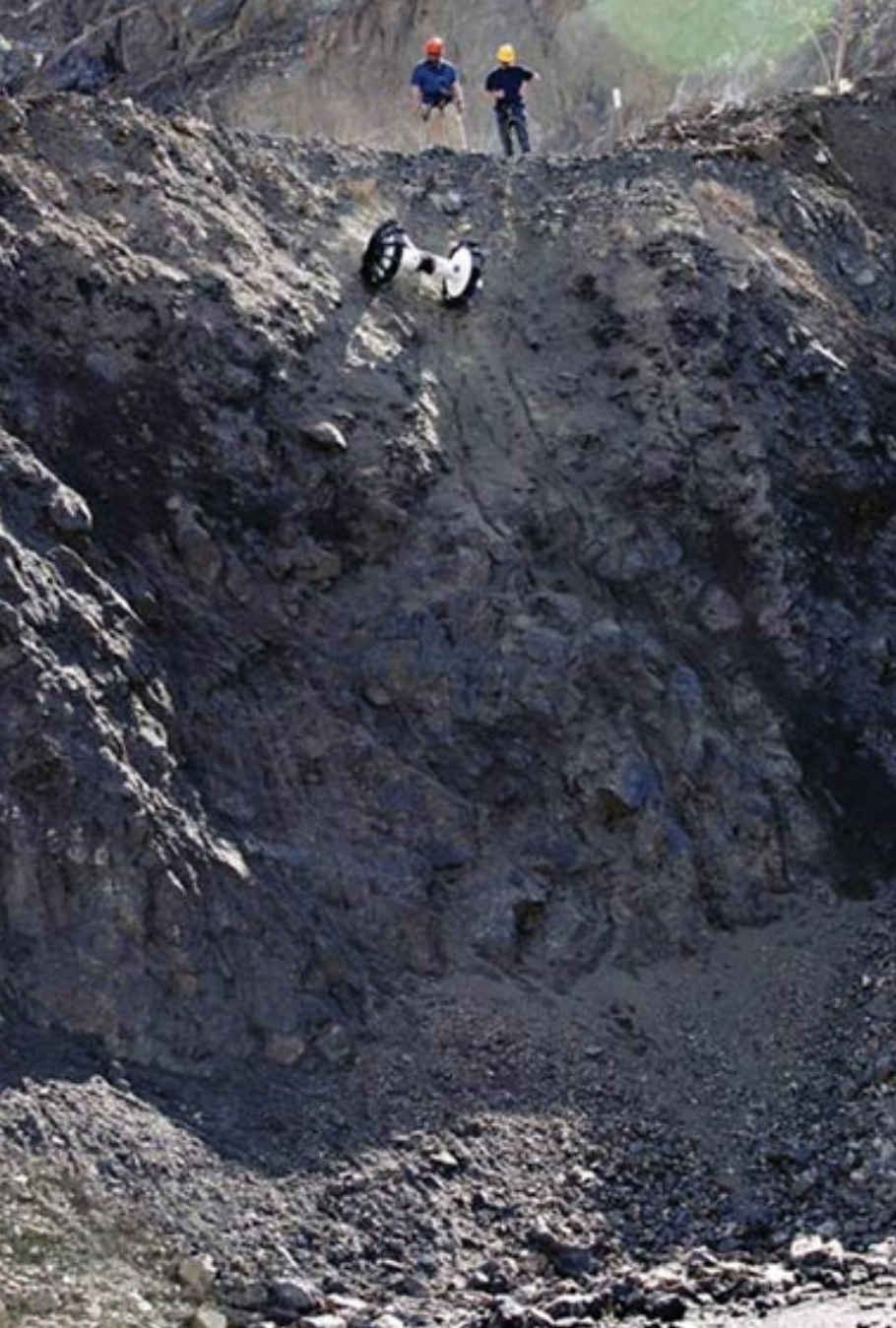 Testing the Axel rover down a 20 m cliff face with slopes ranging from 65 degrees to near-vertical. The tether can support the rover over sheer descents. Credit: Nesnas et al., 2012, Figure 18.
