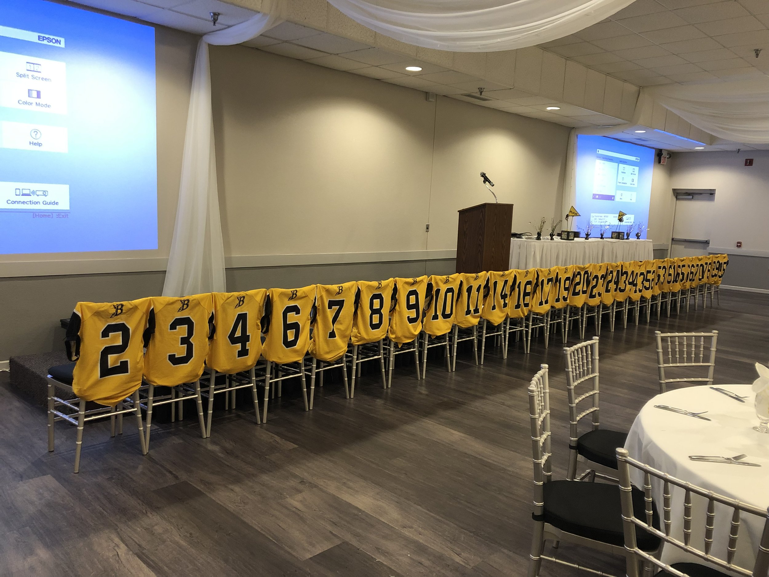 High School Banquet Hall in Eagan for sports award ceremony | Burnsville High School Football | jerseys on the back of the chairs