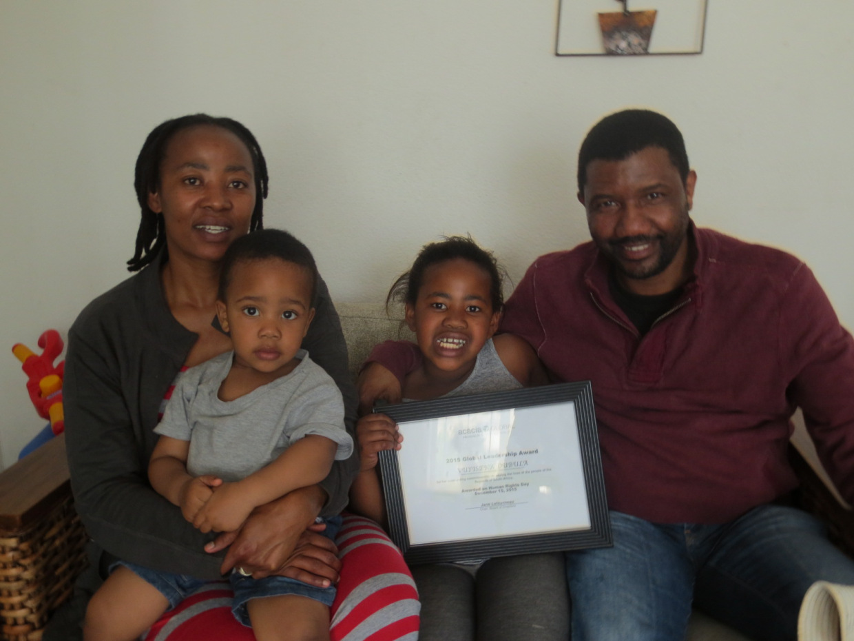 "Vuyiseka Dubula and Mandla Majola, with their children and Vuyiseka's ""2016 Global Leadership Award."""
