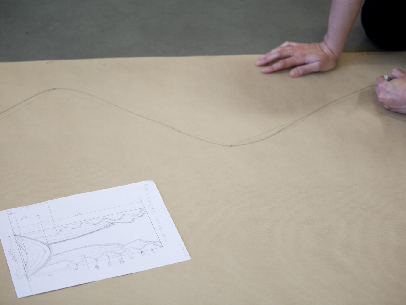 Creating a Decor - In order to cut a fabric or stitch a trim with peace of mind it is first necessary to conceive, design and craft the décor. Once the design is finalized, the seamstresses create a full-sized mock-up of the pleats in the workshops, for a final and meticulous check prior to packing and dispatch