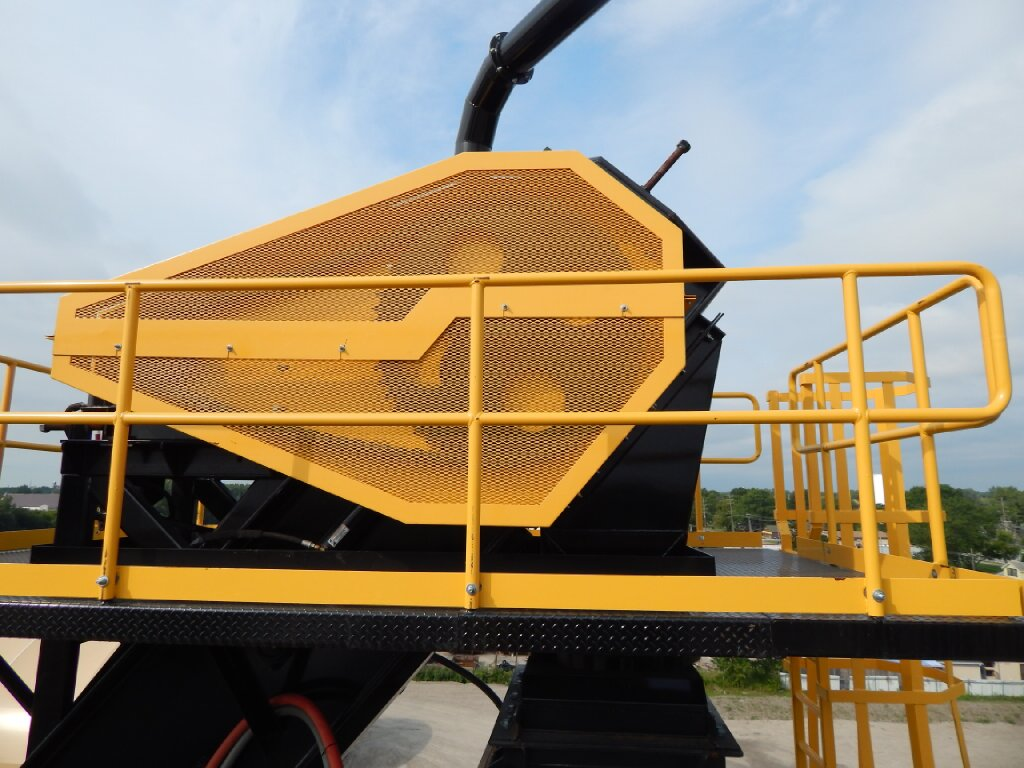 Drag conveyor drive with mesh guard.