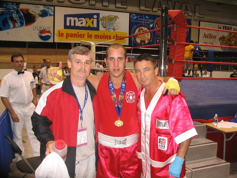 Mike Lazarri (center) shows off his Gold Medal, flanked by WPFG Ed Brown (left) and Bobby McGuire (right)