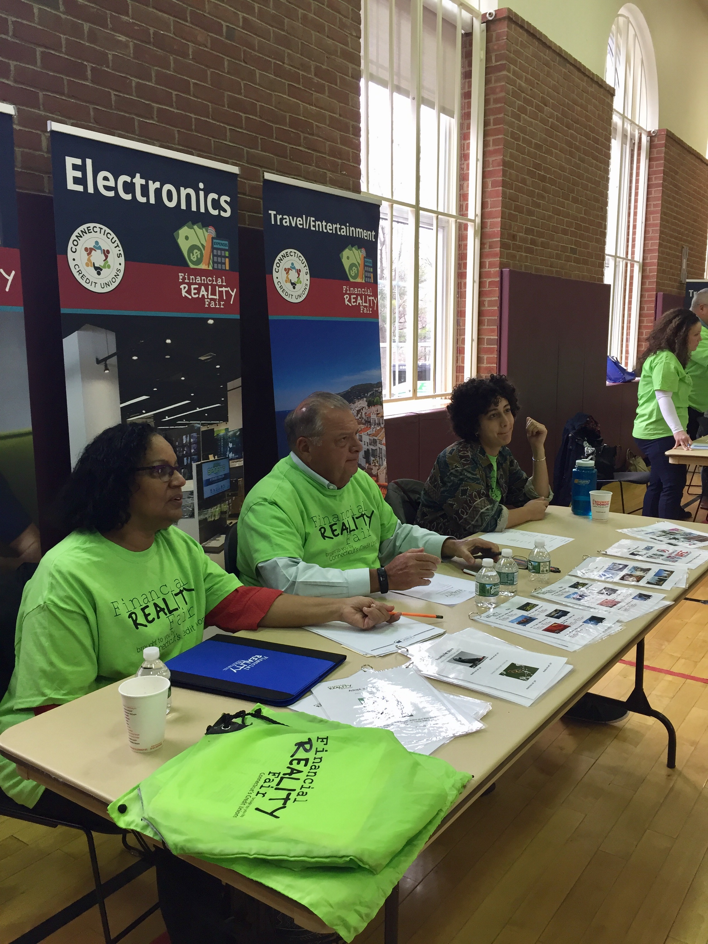 Volunteers at a booth at the reality fair