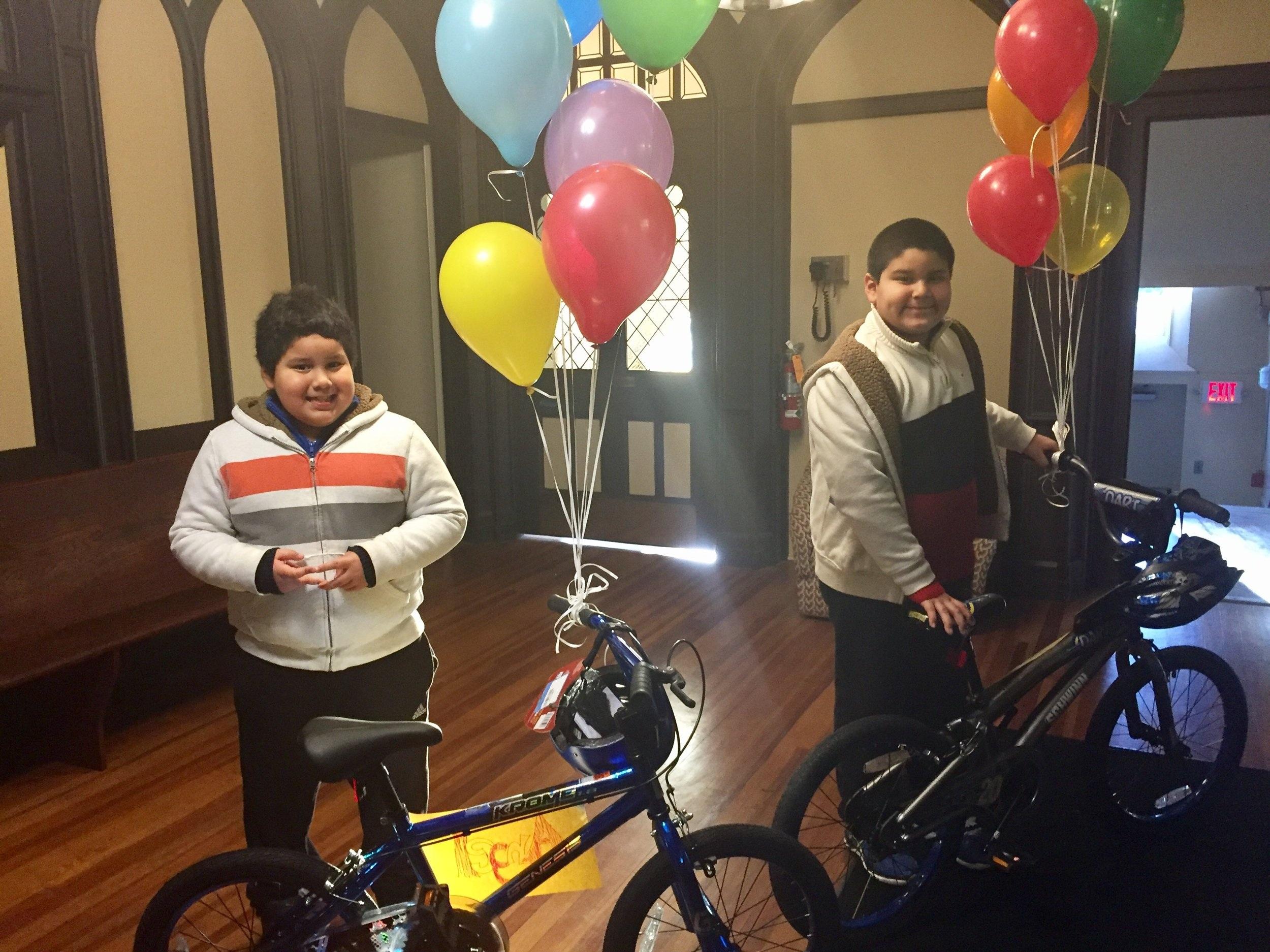 Children smiling on bikes