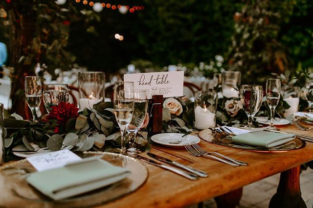A beautiful farmhouse table for the Wedding Party! Wedding Coordinator | @k.sageevents  Catering | @24carrotscatering  Venue | @franciscangardens  Photographer | @whitneydarling  Dj | @extremedjservice  Floral | @growinggrace_fd  Limo | @lakeforestlimos Rentals | @sigpartyrentals  Cake | @simplysweetweddings  Hotel | @lagunacliffs