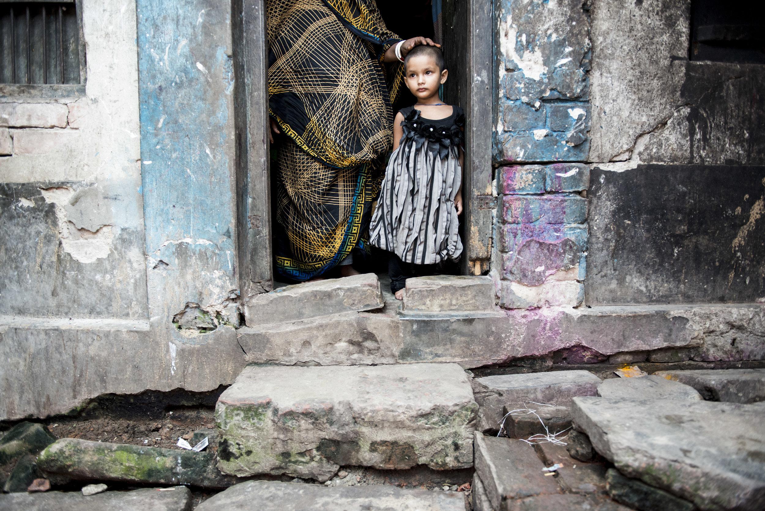Mother and child, Daulatdia brothel. Bangladesh. 2014.
