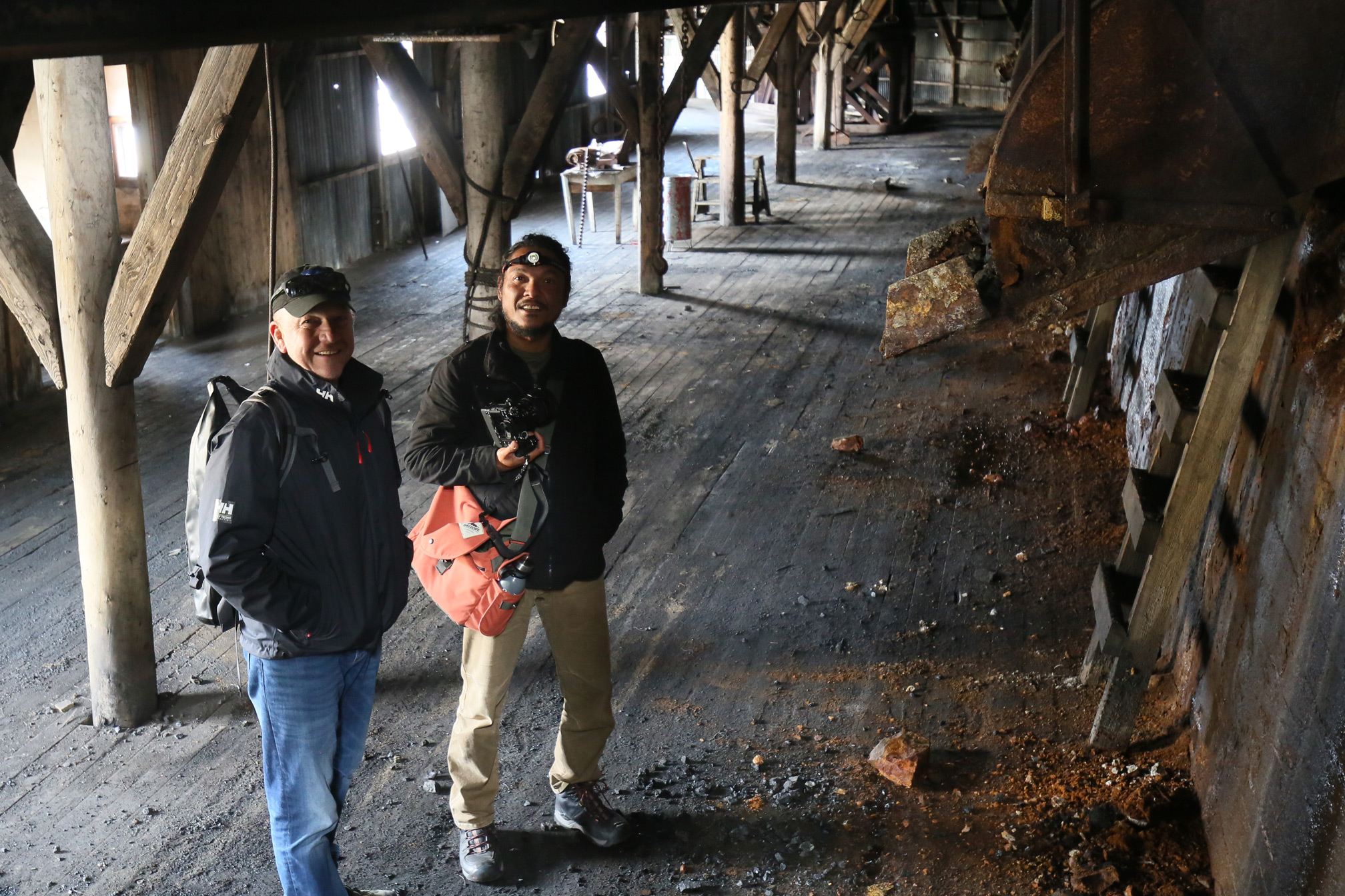 Exploring the coal mining headworks with Cobus and Blackjack.