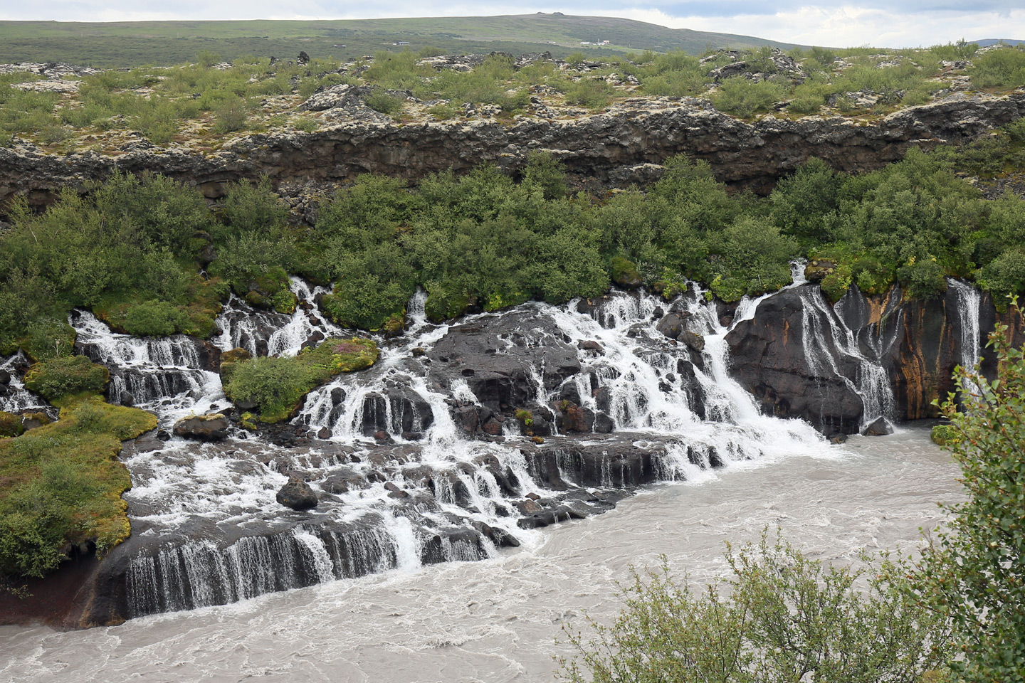 Hraunfossar waterfall, with groundwater emerging from a lava flow into a glacial meltwater stream.