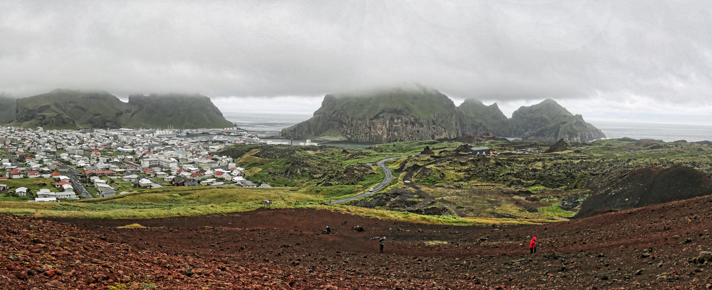 View of Heimaey and harbor from northern flank of Eldfjell volcano.