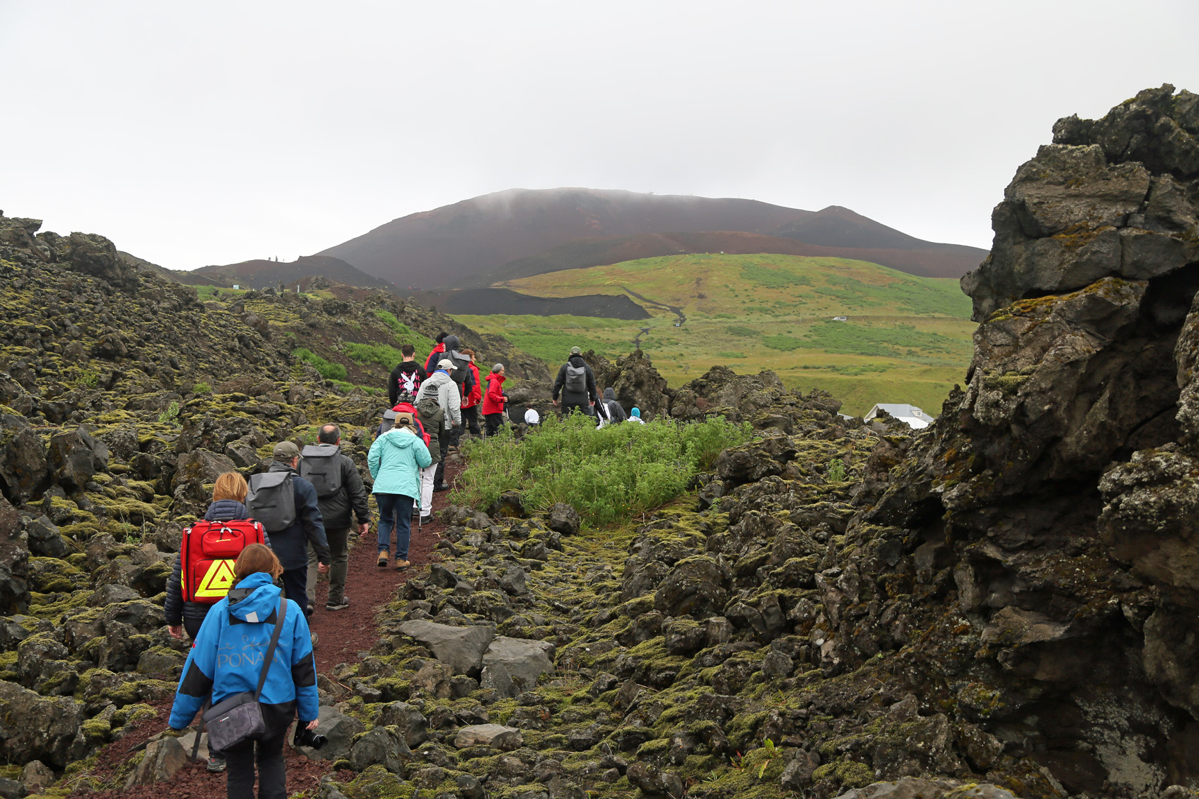 Hiking the recent lava flow towards Eldfjell volcano in the mist.