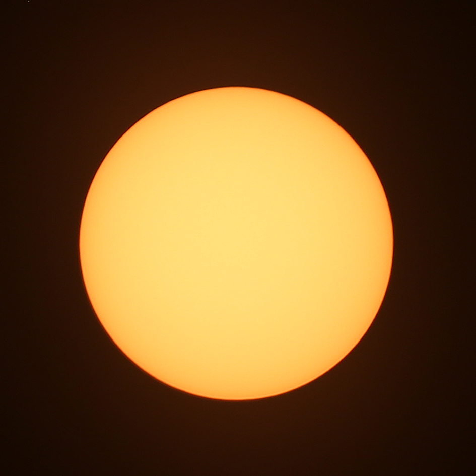 Tripod-mounted Canon 6D with solar filter at 300 mm, ISO 100, 1/13th sec @ f/6.3.