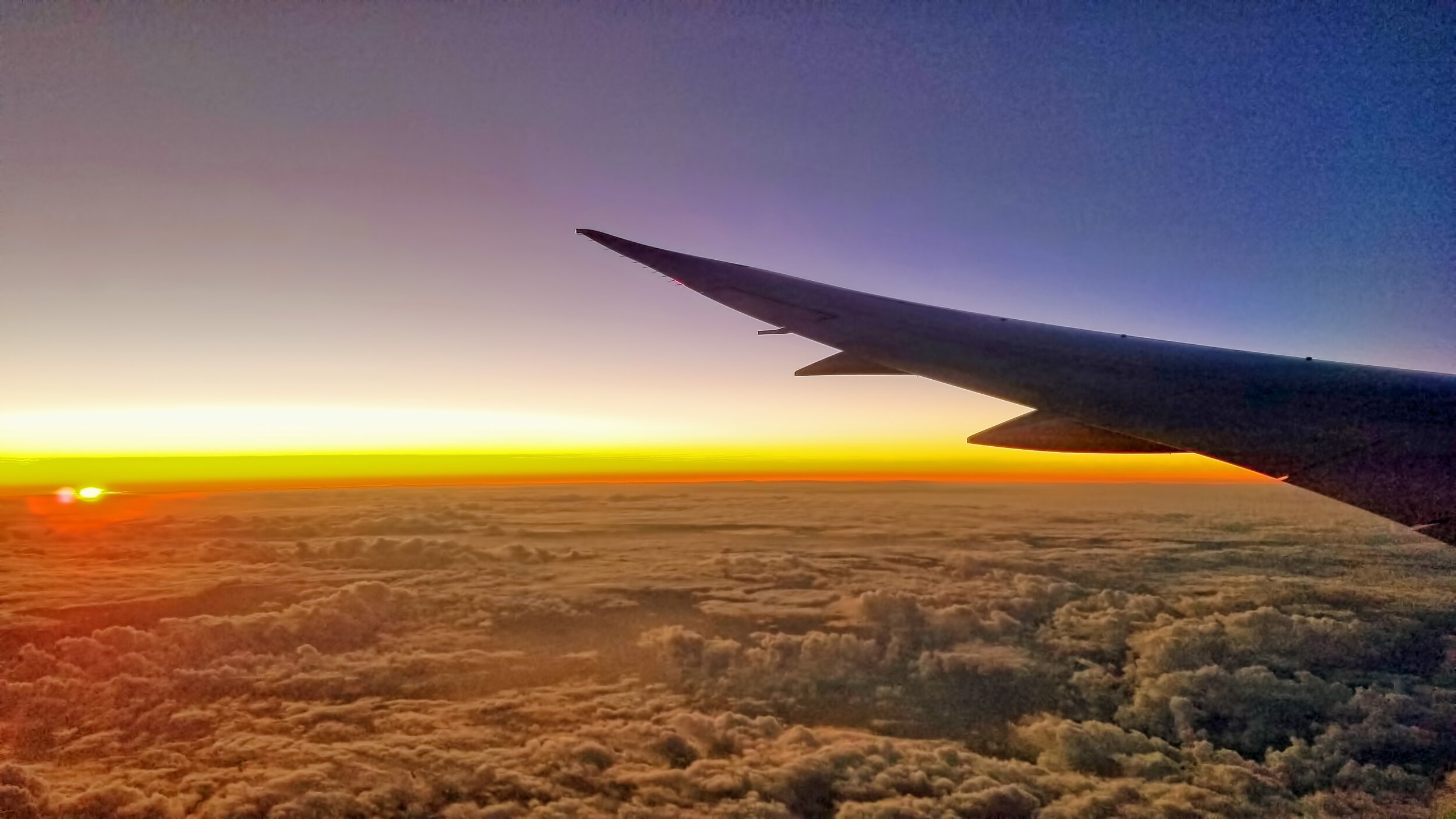 Sun rise across the International Date Line on approach to Brisbane, Australia.