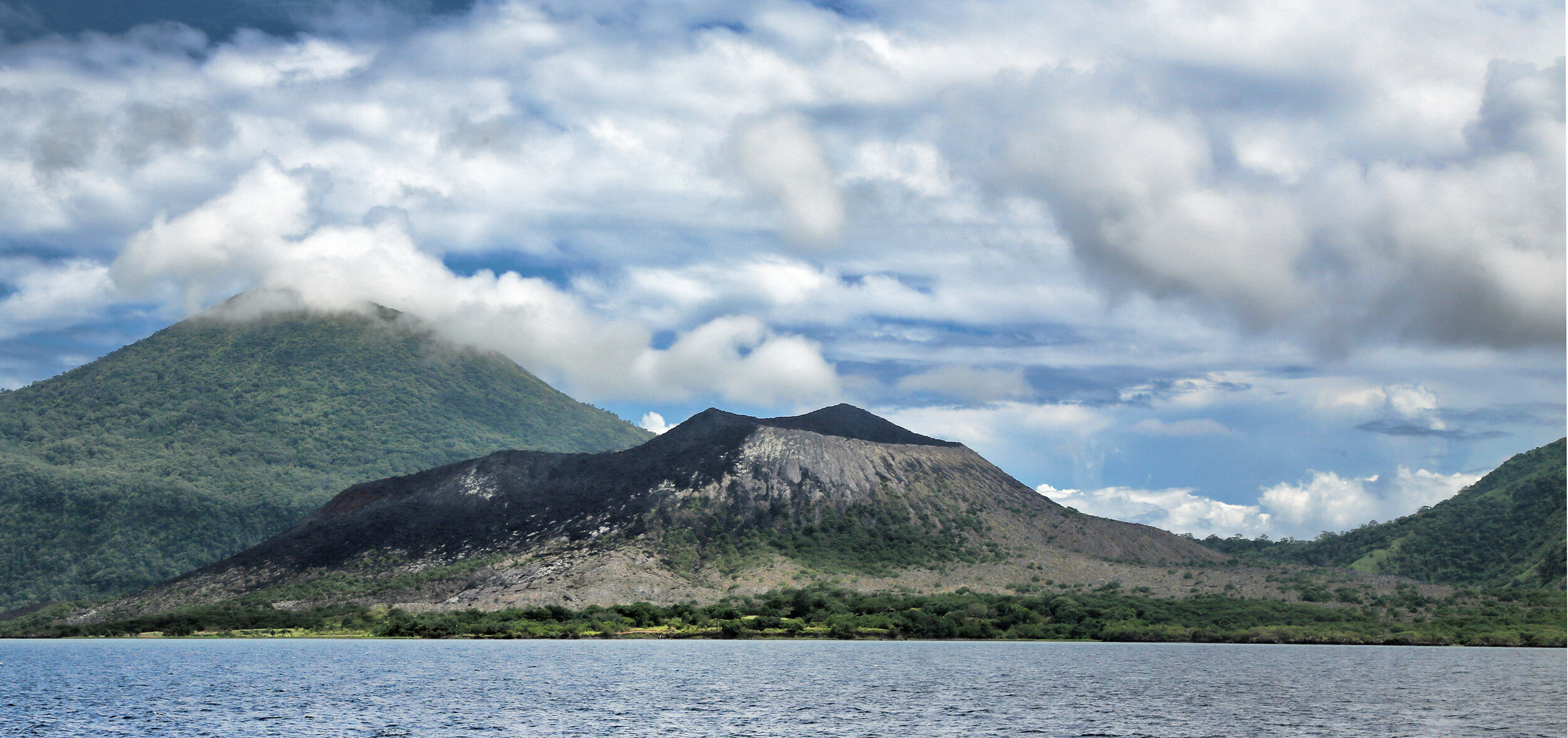 View of Tavurvur from the ship as we enter the harbour within the caldera.  This is approximately the same vantage point as that seen in the dramatic video linked below.