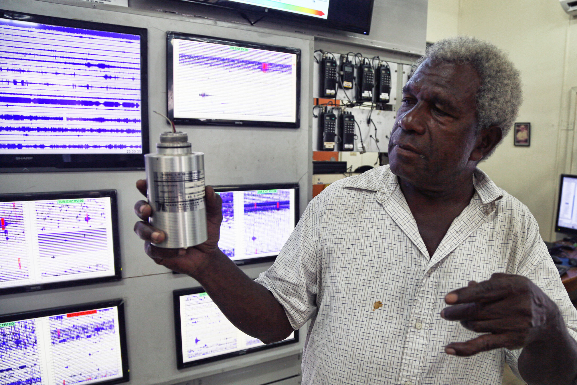 A staff member of the well-equipped Rabaul Volcano Observatory holds a modern seismometer. This lab was just recently outfitted two months ago with the assistance of the USGS and VDAP.
