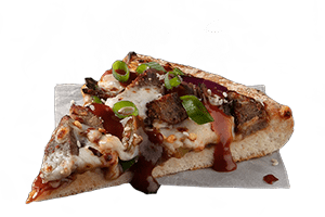 KOREAN BBQ STEAK - Tender steak, red onion and capsicum served on a BBQ sauce base topped with chilli flakes, spring onion, sesame seeds & a sweet smoky Korean sauce.
