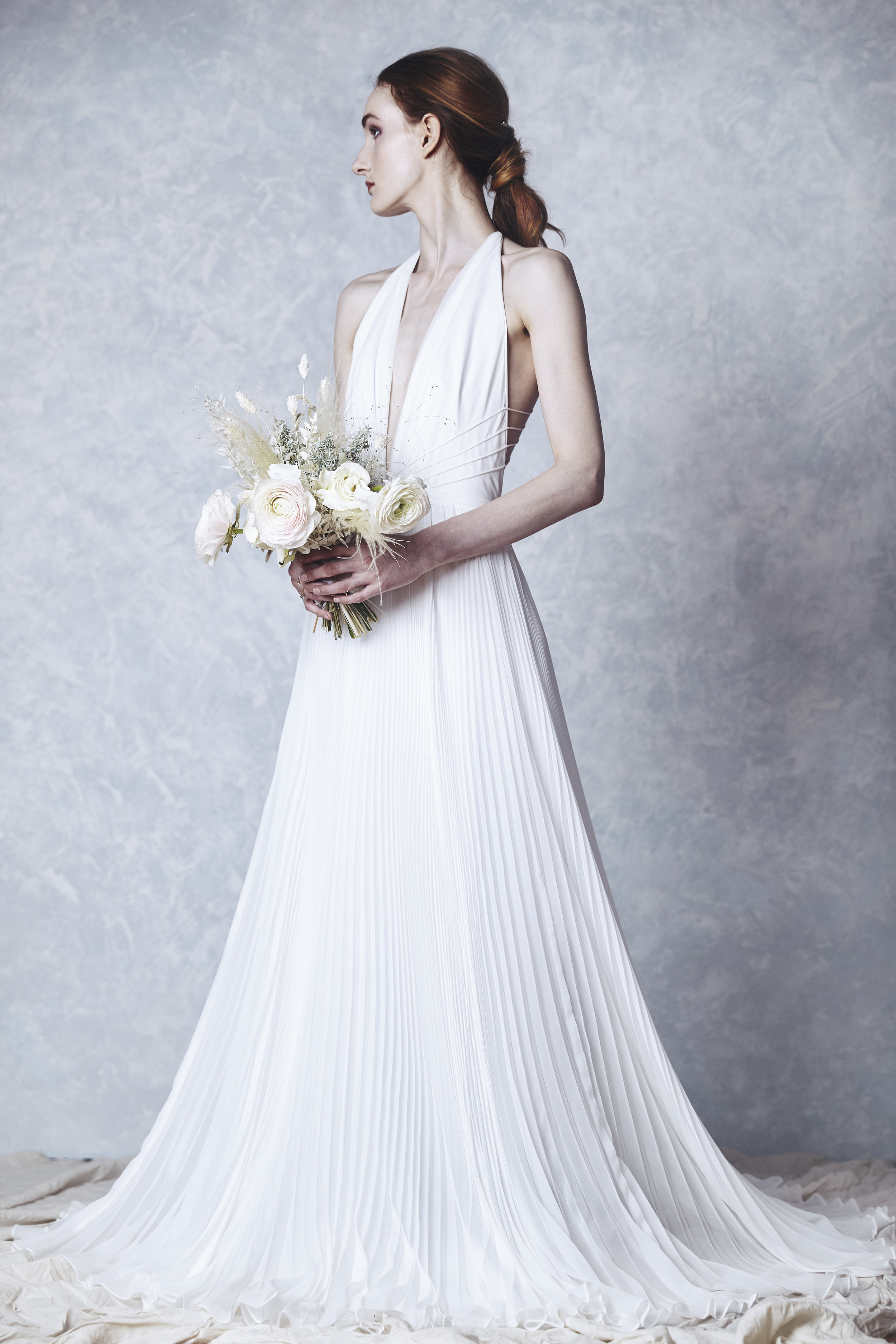 PENELOPE  Halter neckline with pleated skirt and delicate strap back.   Photo: Tiffany Sin