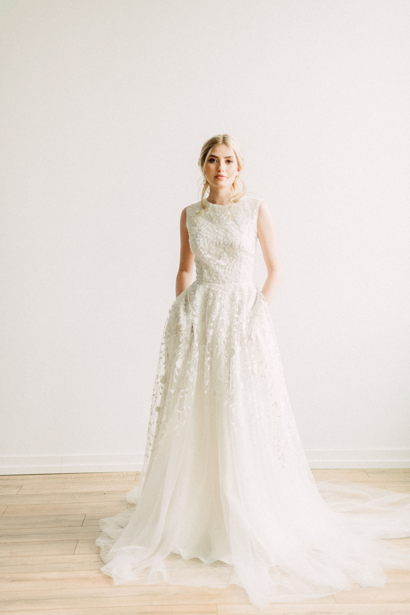 EDEN  Vintage lace embroidered overlay and high neckline, as well as pockets and subtle high low skirt.    Photo: Lace & Luce